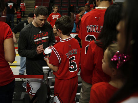 Bulls' Jimmer Fredette signs an autograph before Game 1.