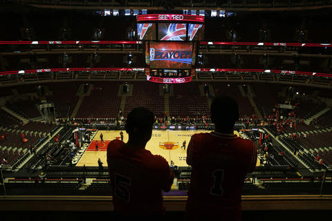 Two fans survey the scene before Bulls play the Wizards in Game 1.