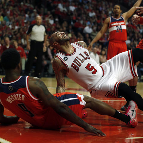 Carlos Boozer looks at his shot after being fouled by the Wizards' Martell Webster.
