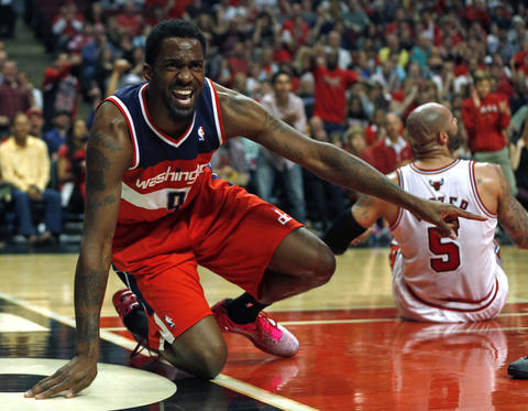 The Wizards' Martell Webster complains about a foul call while defending Carlos Boozer.