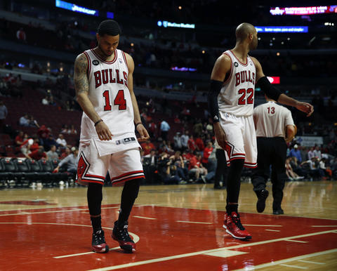 D.J. Augustin and Taj Gibson walk off the court at end of the 102-93 loss.