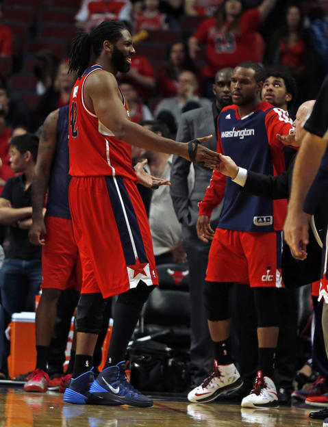 The Wizards' Nene smiles after fouling out in the final minute of the Game 1 win.