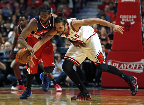 The Wizards' Nene steals the ball from Joakim Noah in the 4th quarter.
