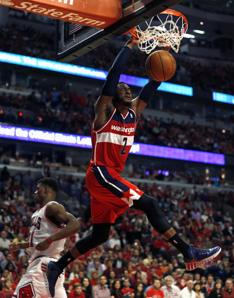 The Wizards' John Wall dunks during the third quarter.