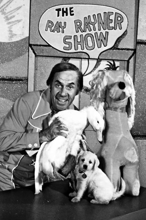 "Ray Rayner on the set of ""The Ray Rayner Show"" with Chelveston the duck and Cuddly Dudley, in the mid-1970's."
