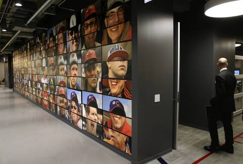A mural featuring Chicago sports teams and faces grace the 17th floor of the new Motorola facility leading into the game room.