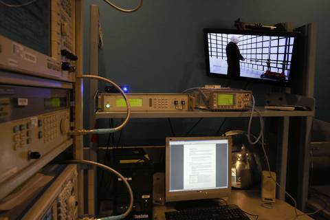 A video screen shows the antennae testing lab.