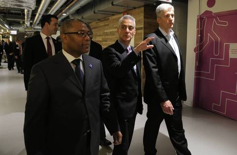 Taking a tour of the Motorola Mobility headquarters are from left, Alderman, Walter Burnett, Jr., 27th, Mayor Rahm Emanuel and Rick Osterloh, President of Motorola Mobility.