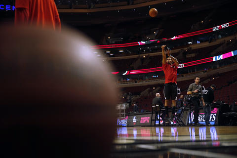 Derrick Rose shoots baskets before Game 2 at the United Center.
