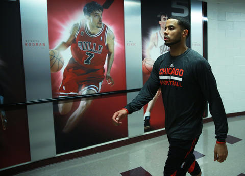 D.J. Augustin heads to the locker room at the United Center before Game 2.