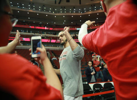 Joakim Noah high-five's with fans at the United Center before Game 2.