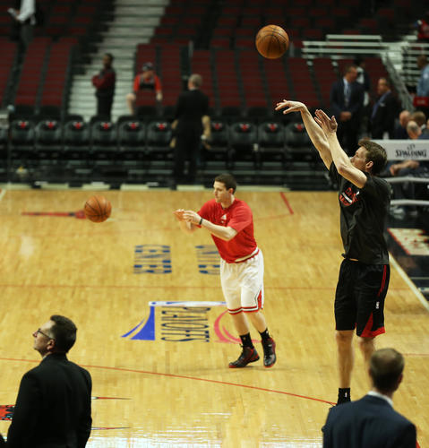 Jimmer Fredette and Mike Dunleavy during pregame warm-ups.