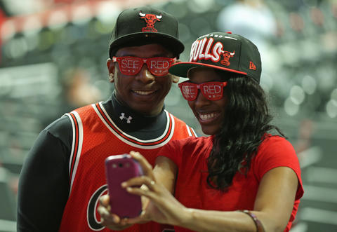 Monique and Preston Curry take a picture of themselves at the United Center before Game 2.