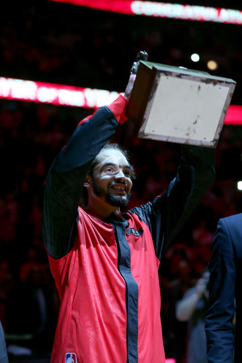 Joakim Noah hoists the Defensive Player of the Year trophy before Game 2.