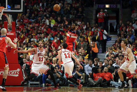 The Wizards' John Wall passes the ball during the first quarter of Game 2.