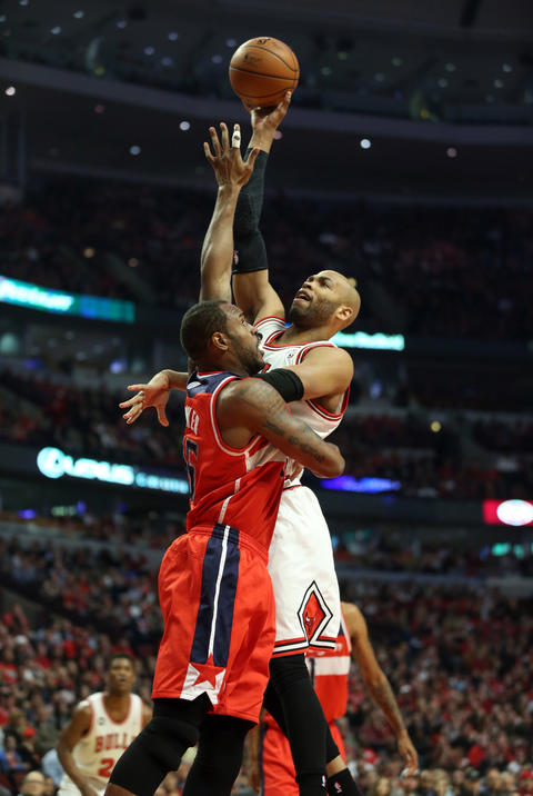 Taj Gibson goes up over the Wizards' Trevor Booker.
