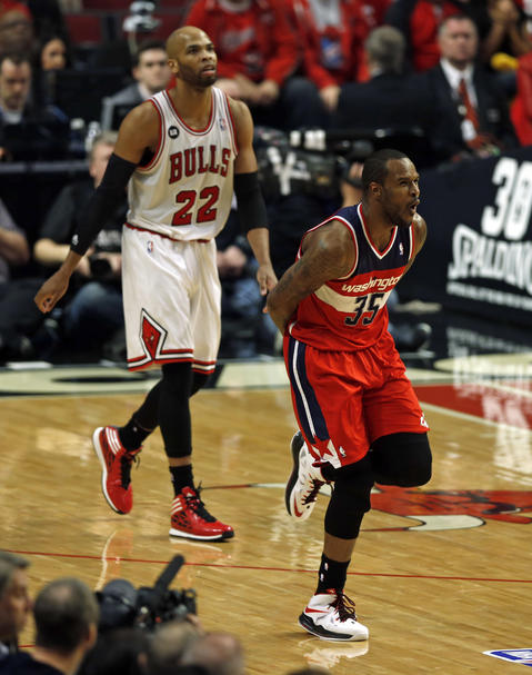 The Wizards' Trevor Booker and Taj Gibson react to Booker's 3-pointer in the first quarter.