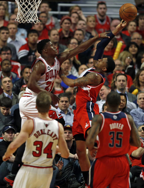 Jimmy Butler fouls the Wizards' Bradley Beal in the first quarter.