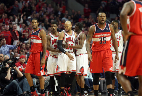 Taj Gibson is fouled by the Wizards' Trevor Booker in the first half.