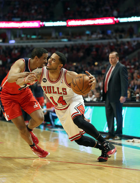 D.J. Augustin is fouled by the Wizards' Andre Miller during the second quarter.