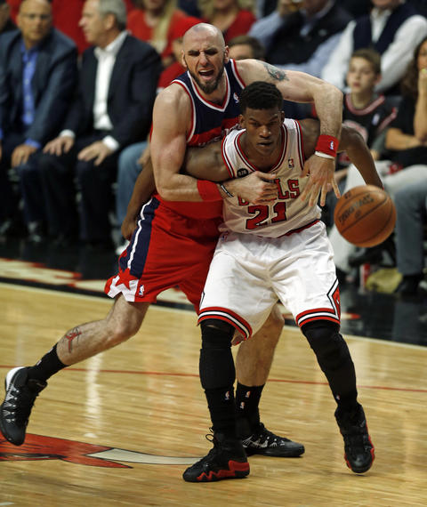Jimmy Butler has the Wizards' Marcin Gortat draped over his back in the 2nd quarter.