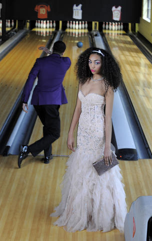 Model Dakota, at right: Joavani gown, $495, Octavia Cross Keys. Earrings, $140, Oliver Weber necklace, $198, hair clip, $97, all from Bijoux. Kate Spade clutch, $398, Handbags in the City. Model Daniel, at left: Jacket, $750, pants, $300, custom shirt, $150, tie, $100, all from Christopher Schafer Clothier. Calvin Klein shoes, $100, Nordstrom.