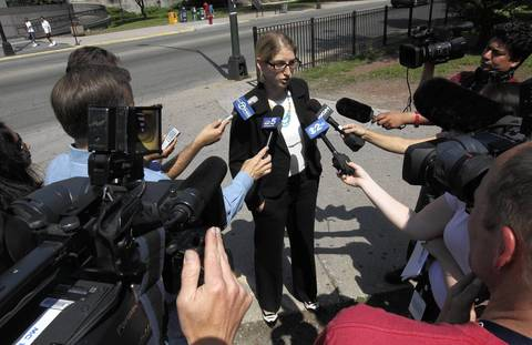 Attorney Sarah Gelsomino, of the People's Law Office, talks with media outside the Cook County Courthouse Saturday morning before the start of the hearing for those arrested during a raid in the 3200 block of South Morgan in Chicago.