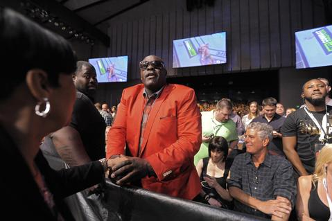 MTV personality Big Black sees a familiar person while foodie Anthony Bourdain (right) looks on at UFC 172.