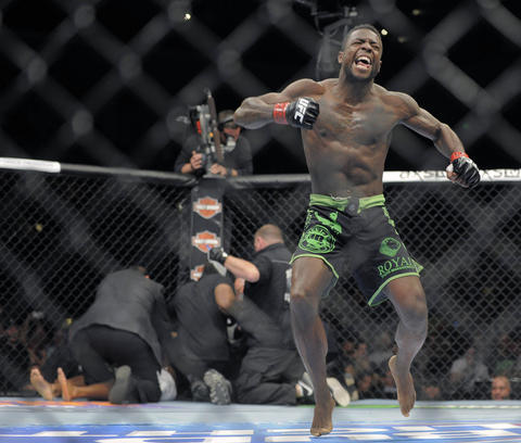Chris Beal (green trunks) reacts after knocking out Patrick Williams (white trunks) during UFC 172.