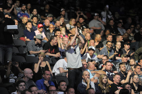 Fans cheer as Danny Castillo (white trunks trunks) Charlie Brenneman (blue trunks) fight during the lightweight bout of UFC 172.