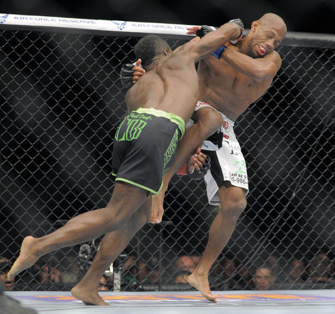 Chris Beal (green trunks) punches Patrick Williams (white trunks) during UFC 172.