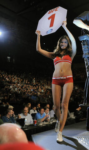 A ring girl as Danny Castillo (white trunks trunks) battles Charlie Brenneman (blue trunks) during the lightweight bout of UFC 172.
