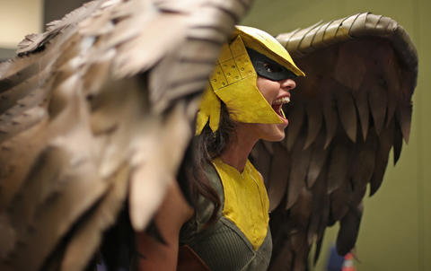 """Kyra Wulfgar, dressed as Hawkgirl from """"Injustice,"""" reacts to a costume she sees during the C2E2 Championships of Cosplay preliminary judging at McCormick Place on Saturday."""