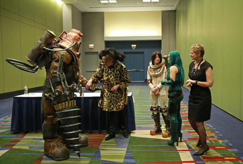 """Kyle Mathis, dressed as """"Bioshock"""" video game character Big Daddy, left, is looked over by judges during the C2E2 Championships of Cosplay preliminary judging at McCormick Place on Saturday."""