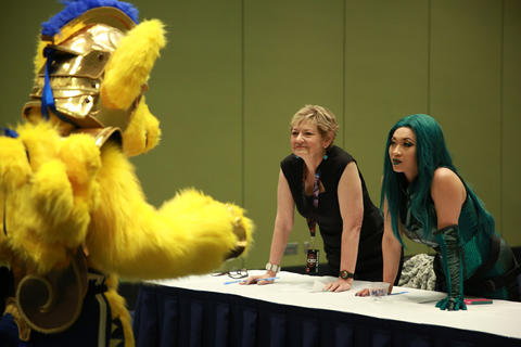 """Judges Yaya Han, right, and Nan Cibula-Jenkins, look over Steve Schertz, dressed as """"My Little Pony"""" character Flash Sentry, during the C2E2 Championships of Cosplay preliminary judging at McCormick Place on Saturday."""