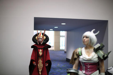 """Lisa Hale, dressed as """"Star Wars"""" character Queen Amidala, left, and Jillian Hendricks, dressed as """"League of Legends"""" video game character Riven, wait to enter the judging room during the C2E2 Championships of Cosplay preliminary judging at McCormick Place on Saturday."""