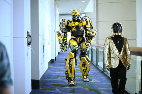 """Thomas DePetrillo Jr., dressed as """"Transformers"""" character Bumblebee, walks to the main stage for the C2E2 Championships of Cosplay judging at McCormick Place on Saturday."""
