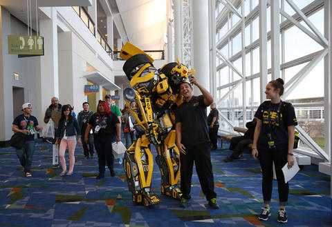 """Thomas DePetrillo Jr., dressed as """"Transformers"""" character Bumblebee, poses for a picture while heading to the C2E2 Championships of Cosplay judging at McCormick Place on Saturday."""