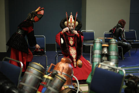 """Lisa Hale, dressed as Star Wars character """"Queen Amidala,"""" center, checks her makeup before the C2E2 Championships of Cosplay judging at McCormick Place on Saturday."""