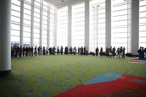 Attendees wait in line to enter the main stage room for the C2E2 Championships of Cosplay judging at McCormick Place on Saturday.