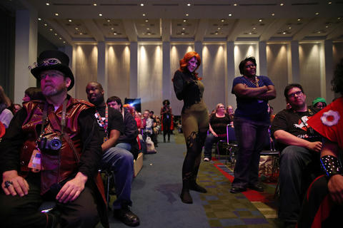 Attendees watch the C2E2 Championships of Cosplay judging at McCormick Place on Saturday.
