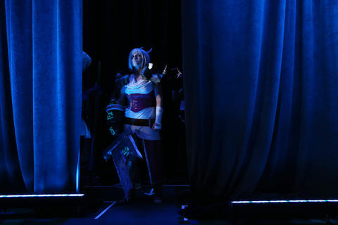 """Jillian Hendricks, dressed as """"League of Legends"""" video game character Riven, waits to take the stage during the C2E2 Championships of Cosplay judging at McCormick Place on Saturday."""