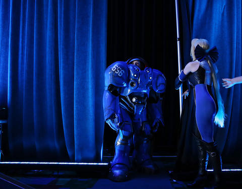 """A woman dressed as """"Starcraft"""" video game character Terran Marine walks toward the stage during the C2E2 Championships of Cosplay judging at McCormick Place on Saturday."""