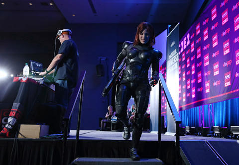 """Freya Willia, dressed, as """"Mass Effect"""" video game character Commander Shepard, exits the stage during the C2E2 Championships of Cosplay judging at McCormick Place on Saturday."""