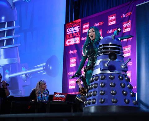 Judge Yaya Han stands next to Barbara Adams, 11, dressed as Nigel the Dalek, during the C2E2 Championships of Cosplay judging at McCormick Place on Saturday.