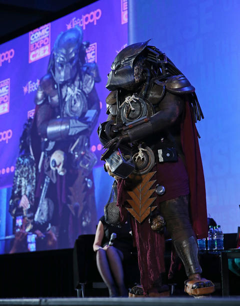 Thomas Kiszcvak, dressed as Predator, competes during the C2E2 Championships of Cosplay judging at McCormick Place on Saturday.