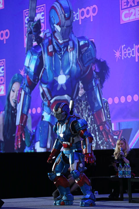 Trevor Walmer, dressed as Iron Patriot, competes during the C2E2 Championships of Cosplay judging at McCormick Place on Saturday.