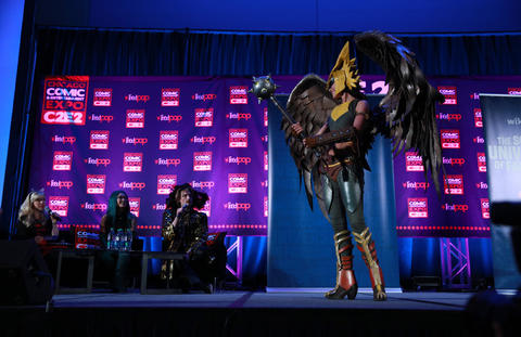 """Kyra Wulfgar, dressed as Hawkgirl from """"Injustice,"""" competes during the C2E2 Championships of Cosplay judging at McCormick Place on Saturday."""