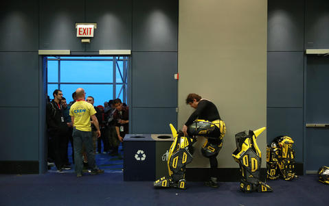 """Thomas DePetrillo Jr. puts on his """"Transformers"""" character Bumblebee costume before the C2E2 Championships of Cosplay judging at McCormick Place on Saturday."""