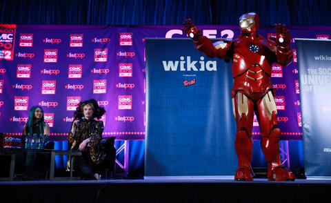 A man dressed as Iron Man competes during the C2E2 Championships of Cosplay judging at McCormick Place on Saturday.